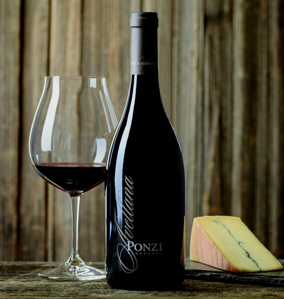 A bottle of the 2014 Ponzi Avellana Pinot Noir with a single glass next to it