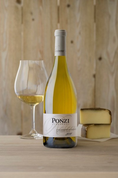 Bottle shot of the 2014 Ponzi Chardonnay Reserve with a glass
