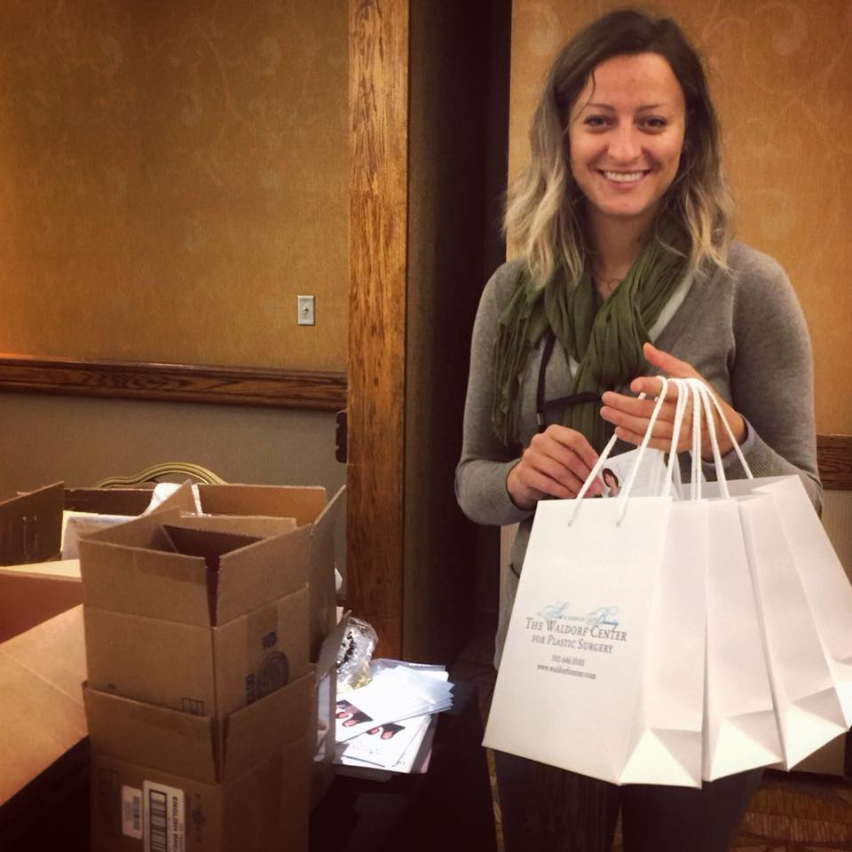 Ponzi staffer stuffs goodie bags at Breast Friends Annual luncheon