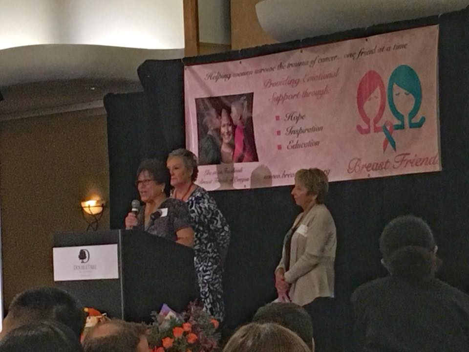 Volunteer of the year accepts her award onstage at Breast Friends