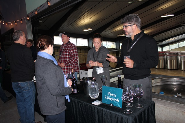 Ponzi Associate Winemaker JP Pierce pours wine at Salud Pinot Noir Auction 2017