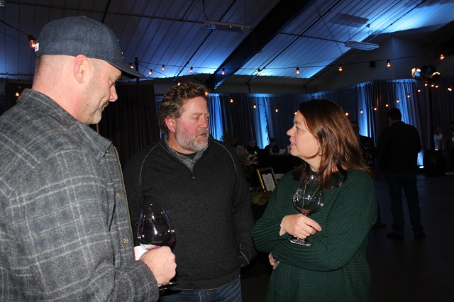 Winemaker Luisa Ponzi chats with other Oregon wine moguls at Salud Pinot Noir Auction 2017
