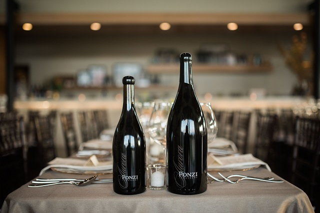 Ponzi single vineyard pinot noir bottles on an elegant table