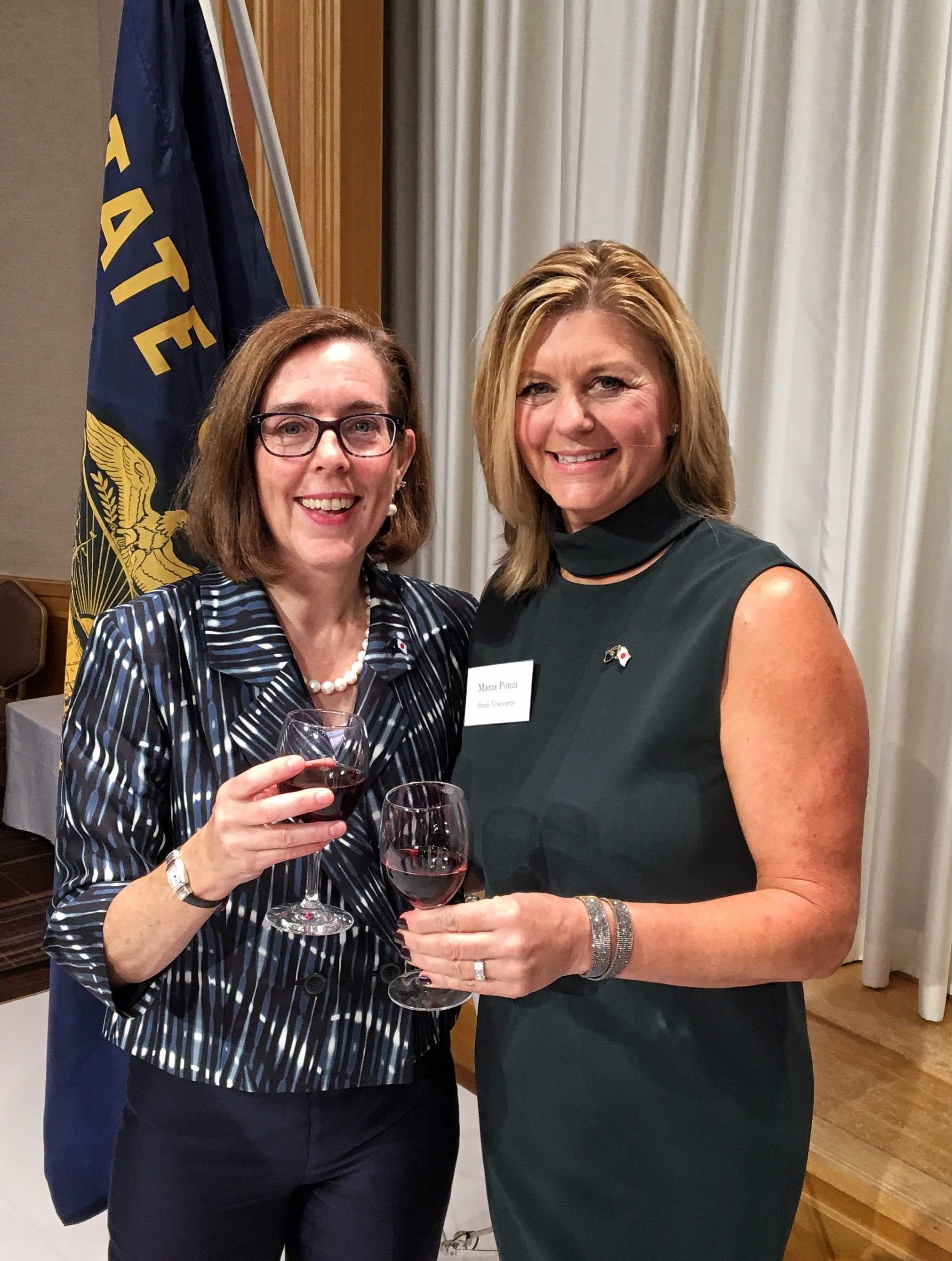 Maria Ponzi Toasts with Oregon Governor Kate Brown 2017