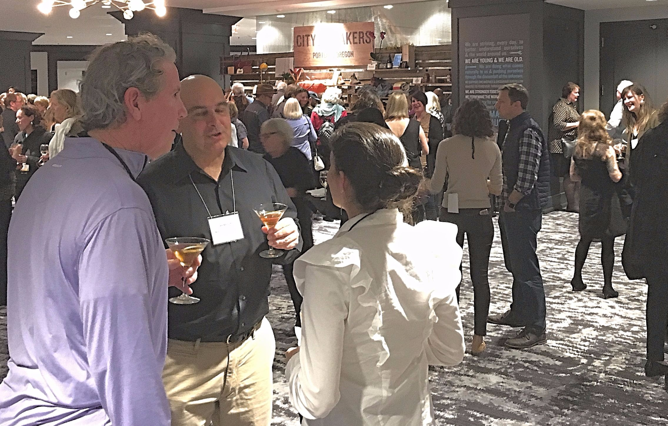 People enjoy a cocktail reception at the SATW 2017 conference